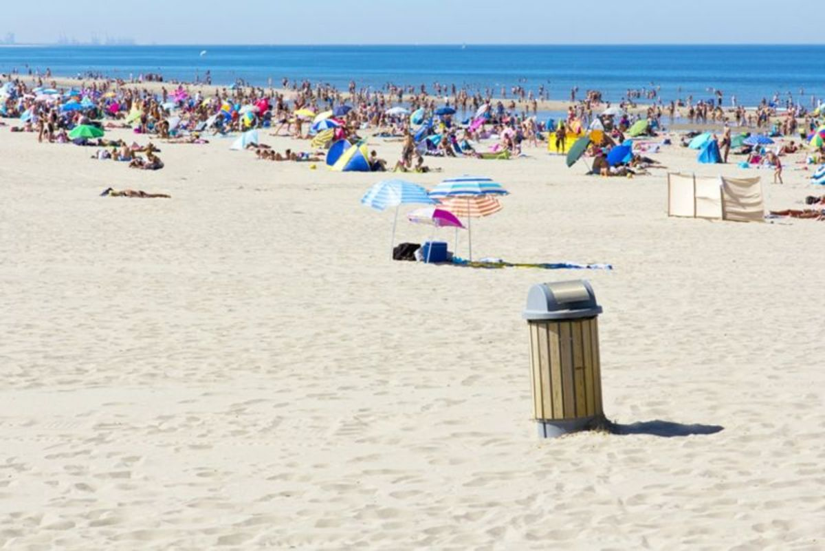 concrete-bin-bin-on-busy-beach-min